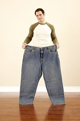 Man who lost weight in his big jeans.